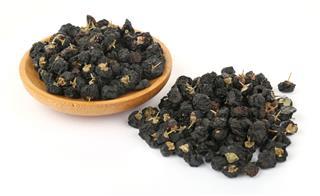Black Goji Wolfberry In Wooden Bowl