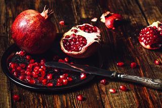 Whole And Opened Pomegranates