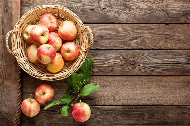 Fresh Apples In Wicker Basket