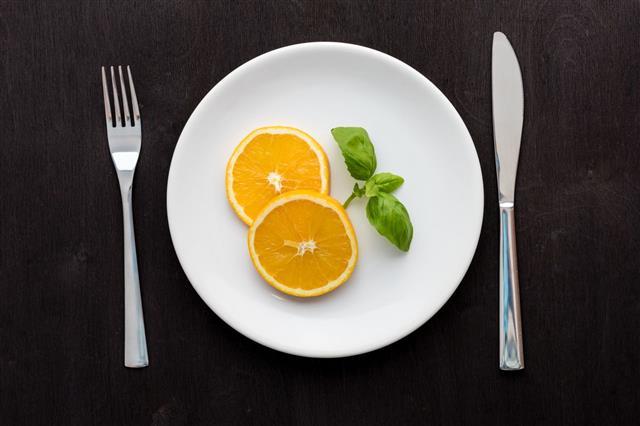 White Plate On Orange