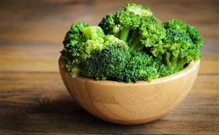 Fresh broccoli on wooden table