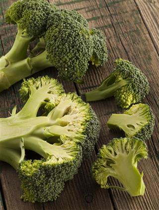 Fresh broccoli on wood board