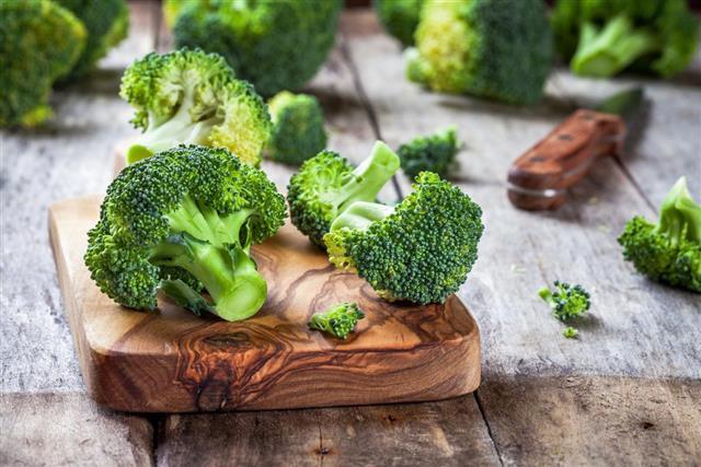 Fresh raw organic broccoli cutting board