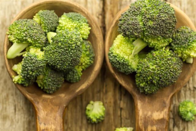 Fresh broccoli in a spoon