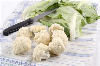 Prepared cauliflower with a kitchen knife