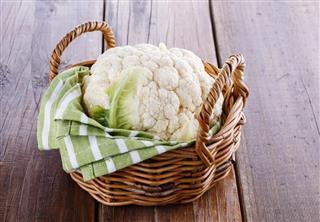 Single cauliflower on woven basket