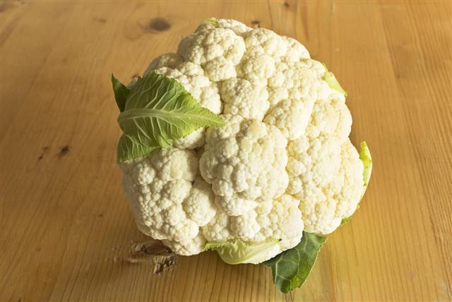 Cauliflower on the plank table