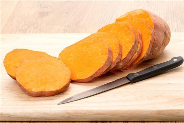 Sweet potato with knife