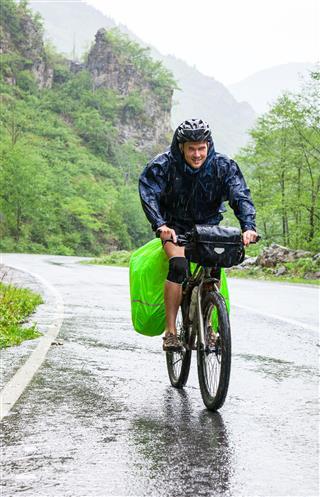 Cyclist Travelling In Rain