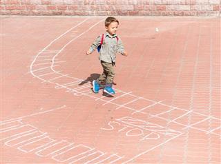 Boy Running Over Pavement