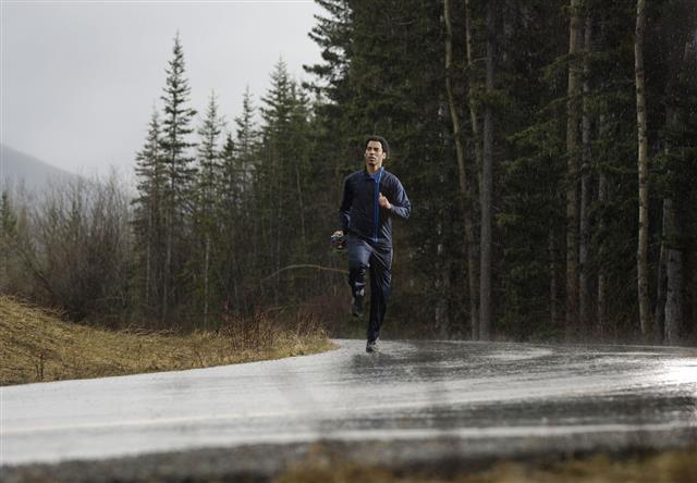Athlete Running In The Rain
