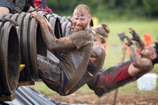 Man Prepares Himself For Muddy Plunge