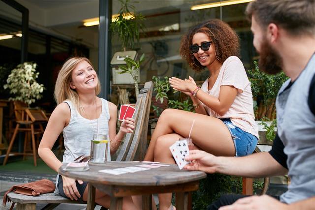People Enjoying Playing Poker Game
