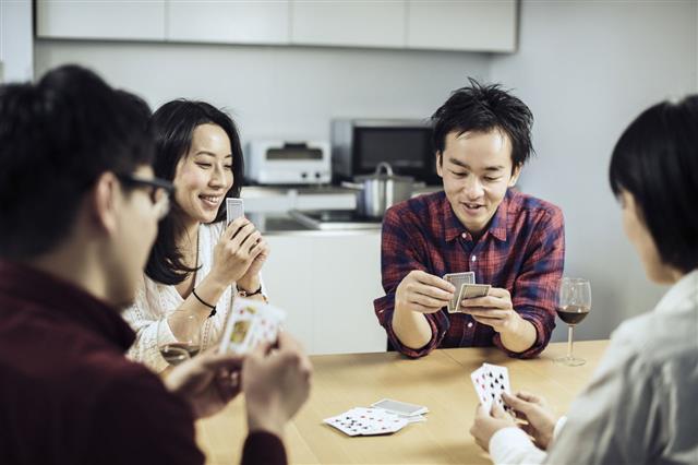 Group Of Friends Enjoying Card