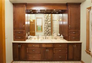 Elegant Hardwood Cabinetry In Bathroom
