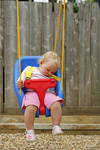 Sleeping Baby In A Swing