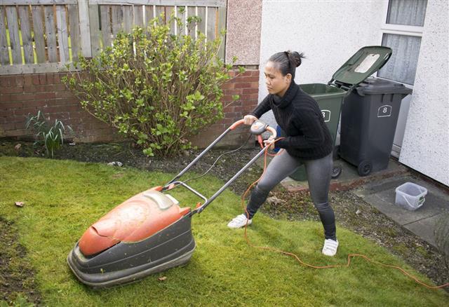 Woman Mowing Lawn