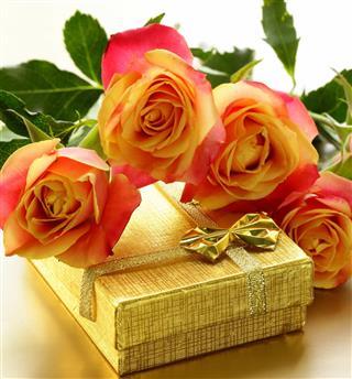 Orange roses and box