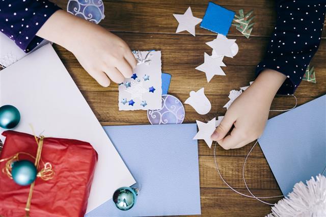 Little Girl Making Christmas Cards