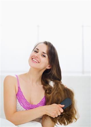 Beautiful Woman Combing Long Hair