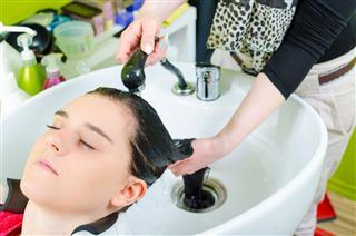 Woman Washing Hair At Hair Salon