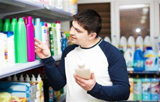 Male Customer Buying Shampoo