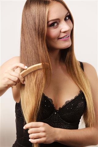 Woman Combing Her Long Hair