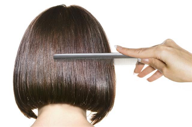 Woman Combing Brown Hair