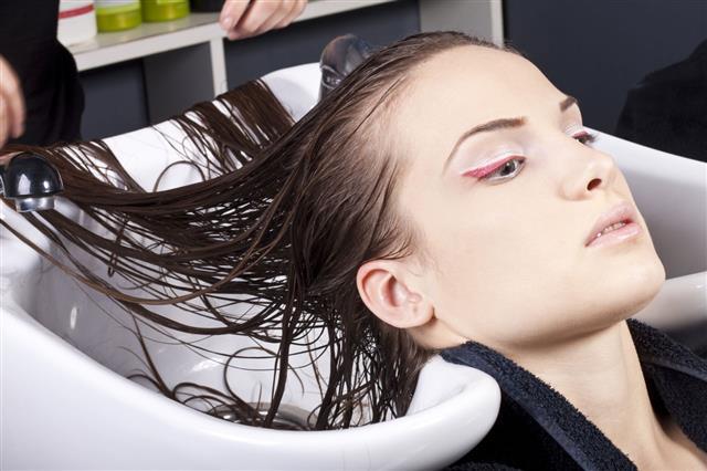 Girl Taking Hair Treatment In Hair Salon