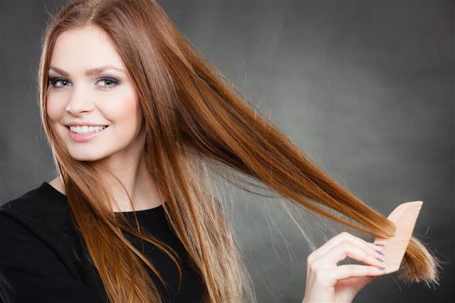 Girl Combing Her Beautiful Hair