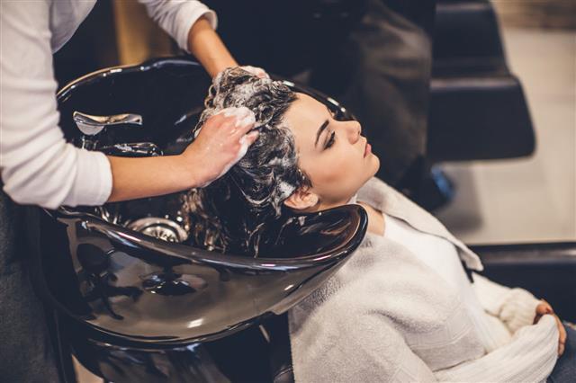 Woman Washing Hair In Beauty Salon