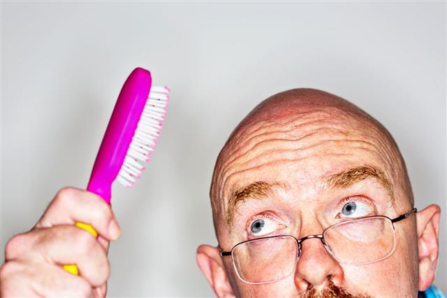 Man Holding Hairbrush