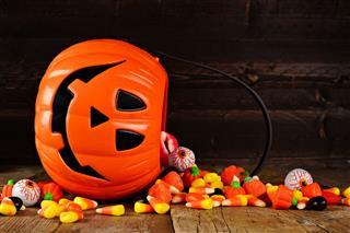 Spilling Halloween Jack O Lantern Candy Pail