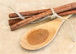 Ground Cinnamon On Wooden Spoon