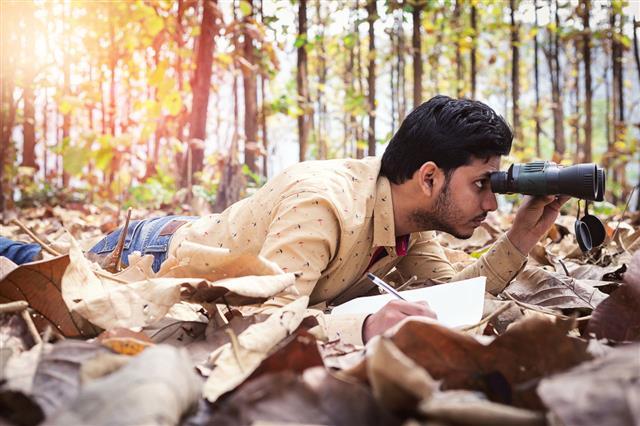 Young Man With Binocular