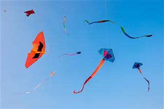 Fancy Kites Against On A Blue Sky