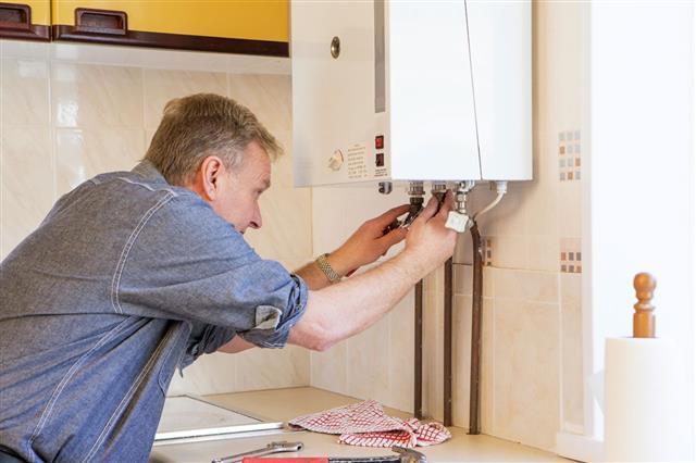 Man Fixing His Boiler