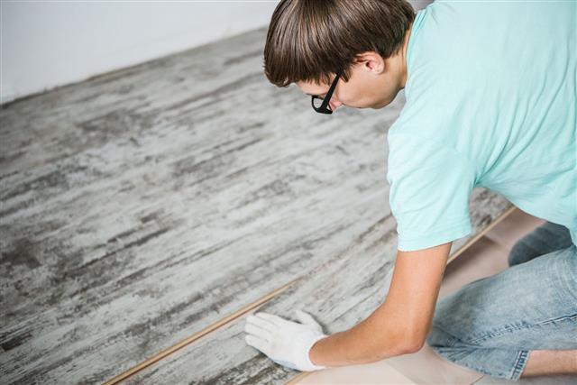 Man Is Repairing Floor