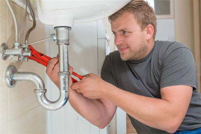 Plumber Repairing Drain