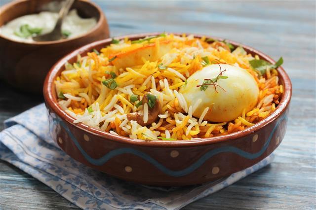 Egg Biryani Served With Yogurt Dip