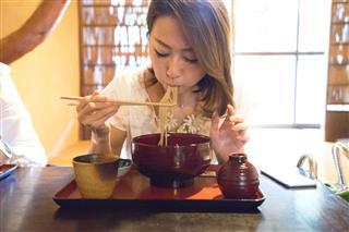 Businesswomen In A Japanese Restaurant
