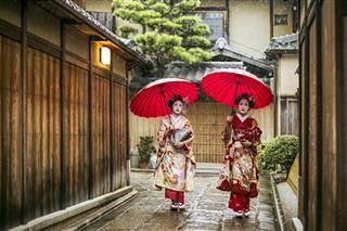 Geishas Holding Red Umbrella