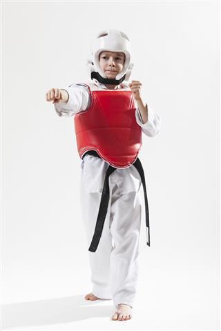 Kid Practicing Tae Kwon Do