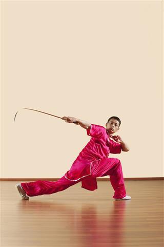 Man Holding Sword At Kung Fu