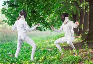 Two Rapier Fencer Women Fighting