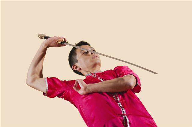 Man Holding Sword
