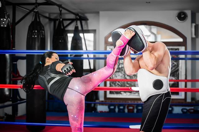 Woman Practicing Kickboxing