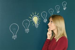 Young Woman Thinking A Big Idea