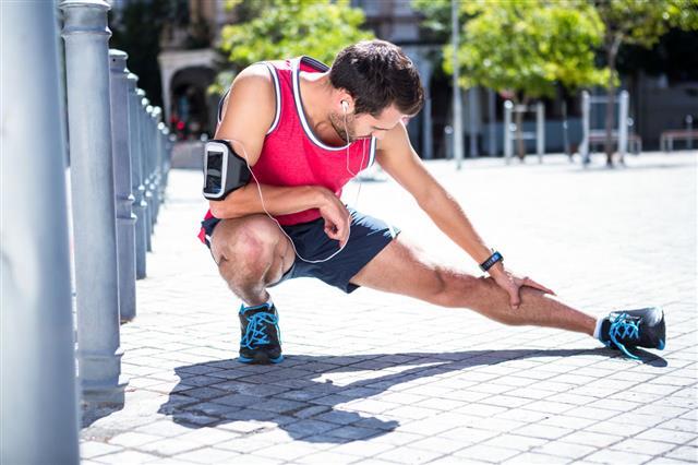 Handsome Athlete Doing Leg Stretching