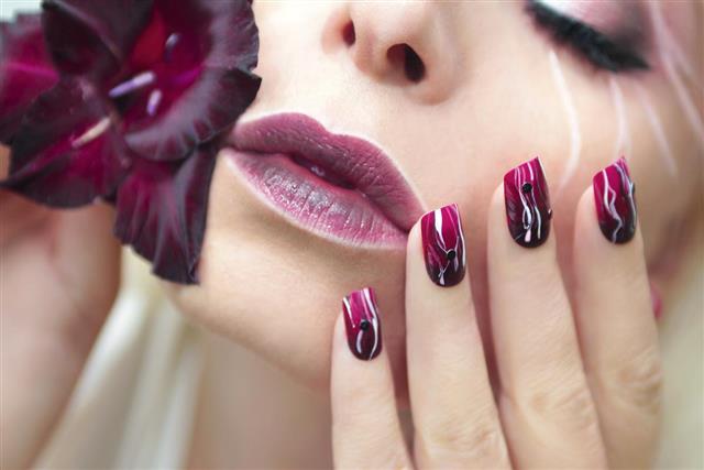 Burgundy manicure with gladiolus